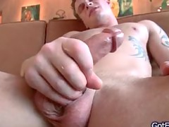 muscled man with tats jerking on couch part2