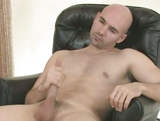 horny bald gay bucky jerking his giant penis on