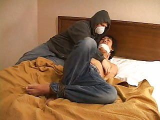 a bandit into mask tied up an eastern  gay and is