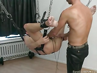 gay bdsm party with penis and balls punch