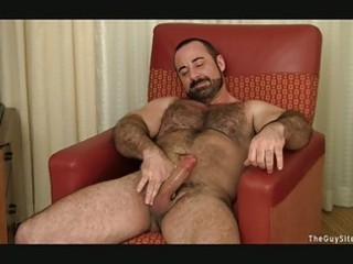 bearded gay hunk jerks off his heavy boner
