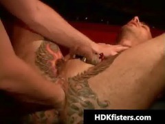 gay fucker gets his tattooed ass fisted gay sex