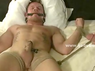 leather dressed gay spanking sex slave before