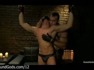 muscle gay whips bound male into dungeon