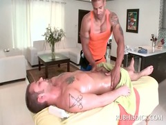 gay black masseur rubbing his clients penis with